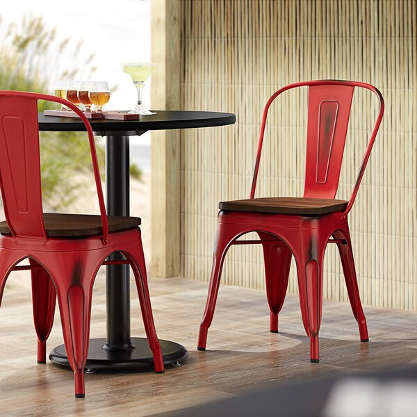 Lancaster Table & Seating Alloy Series Distressed Red Metal Indoor Industrial Cafe Chair with Vertical Slat Back and Walnut Wood Seat Main Image 4