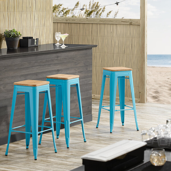 Lancaster Table & Seating Alloy Series Arctic Blue Metal Indoor Industrial Cafe Bar Height Stool with Natural Wood Seat Main Image 3