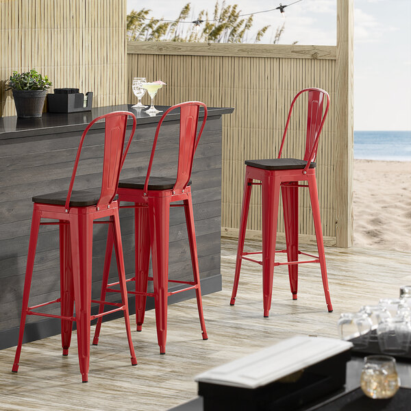 Lancaster Table & Seating Alloy Series Red Metal Indoor Industrial Cafe Bar Height Stool with Vertical Slat Back and Black Wood Seat Main Image 4