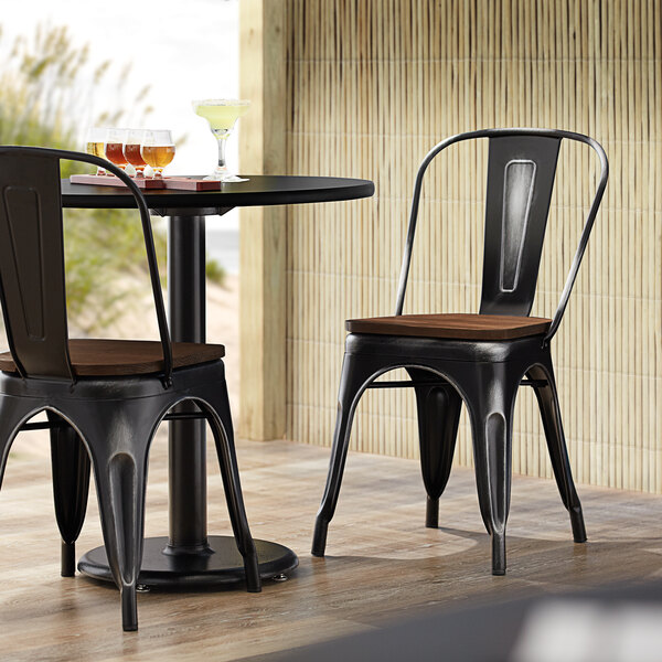 Lancaster Table & Seating Alloy Series Distressed Black Metal Indoor Industrial Cafe Chair with Vertical Slat Back and Walnut Wood Seat Main Image 4
