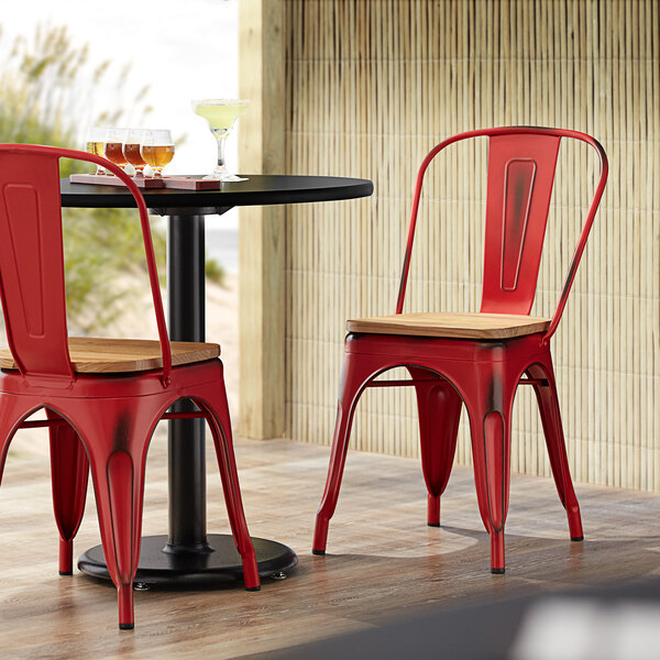 Lancaster Table & Seating Alloy Series Distressed Red Metal Indoor Industrial Cafe Chair with Vertical Slat Back and Natural Wood Seat Main Image 4