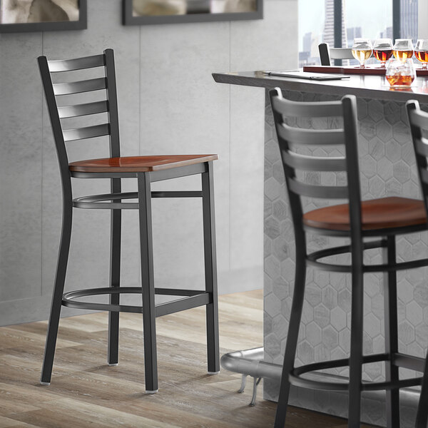 Lancaster Table & Seating Black Frame Ladder Back Bar Height Chair with Antique Walnut Wood Seat Main Image 4