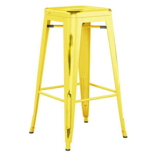 Lancaster Table & Seating Alloy Series Distressed Yellow Stackable Metal Indoor / Outdoor Industrial Barstool with Drain Hole Seat Main Image 1