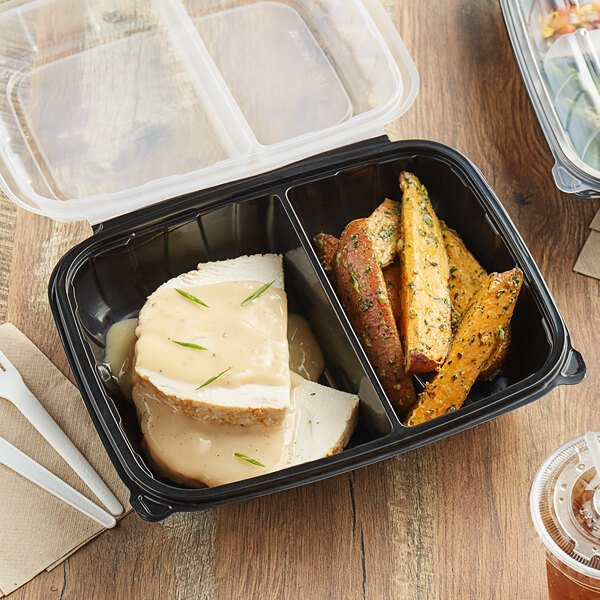 """Choice 11"""" x 8 1/2"""" x 3"""" Microwaveable 2-Compartment Black / Clear Plastic Hinged Container - 100/Case Main Image 4"""