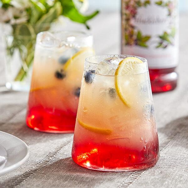 Monin 1 Liter Premium Huckleberry Flavoring / Fruit Syrup Main Image 2