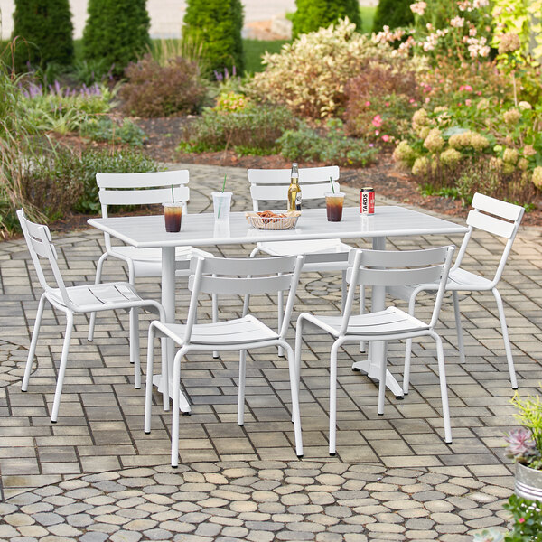 """Lancaster Table & Seating 32"""" x 60"""" White Powder-Coated Aluminum Dining Height Outdoor Table with Umbrella Hole and 6 Side Chairs Main Image 5"""