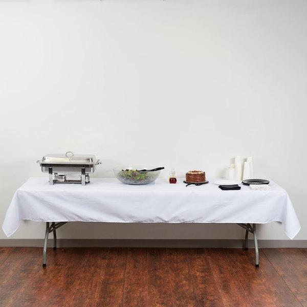 "54"" x 120"" White Hemmed Polyspun Cloth Table Cover"
