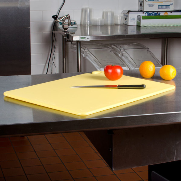 "San Jamar CB182412YE Yellow 18"" x 24"" x 1/2"" Cut-N-Carry Cutting Board with Hook"