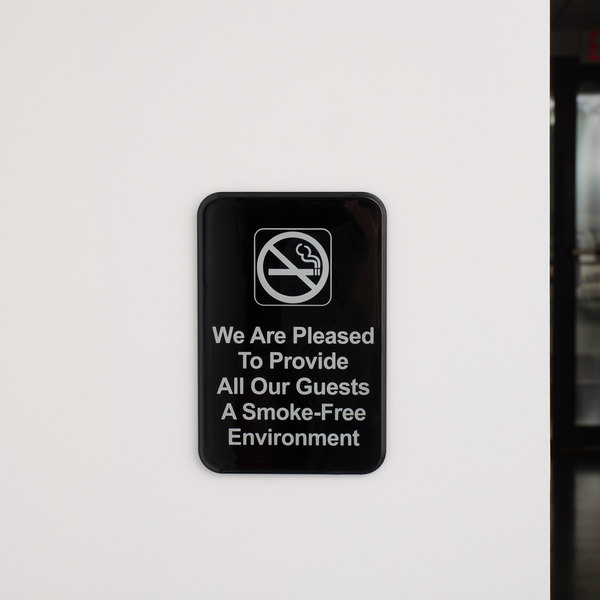 """We Are Pleased To Provide All Our Guests A Smoke-Free Environment Sign - Black and White, 9"""" x 6"""""""