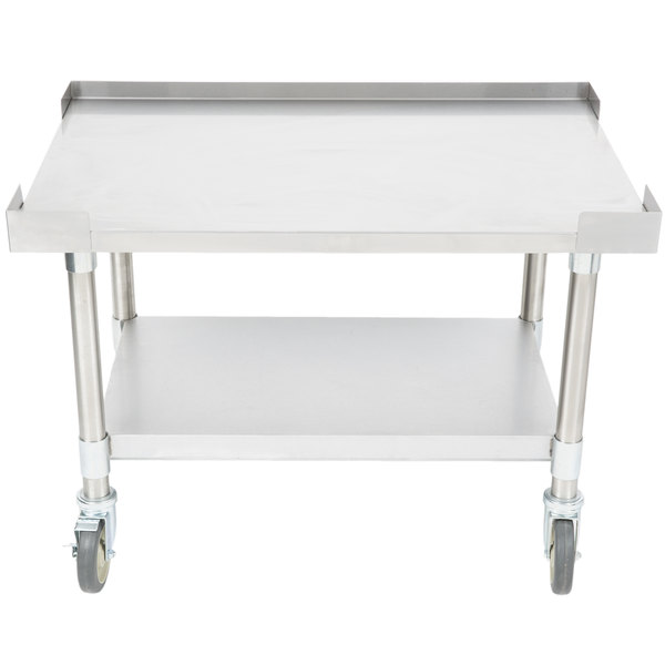 "APW Wyott SSS-36C 16 Gauge Stainless Steel 36"" x 24"" Medium Duty Cookline Equipment Stand with Galvanized Undershelf and Casters"