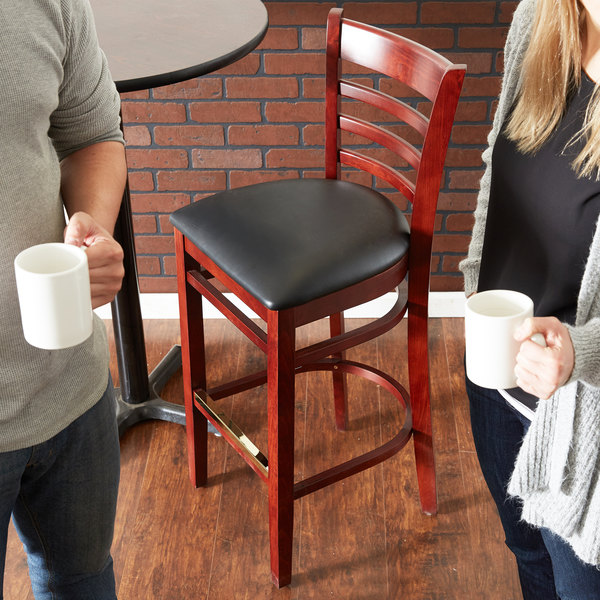 Preassembled Lancaster Table & Seating Mahogany Ladder Back Bar Height Chair with Black Padded Seat