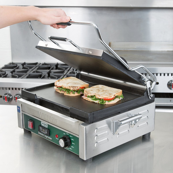 "Waring WFG250T Tostato Supremo Large Smooth Top & Bottom Panini Sandwich Grill with Timer - 14 1/2"" x 11"" Cooking Surface - 120V, 1800W"