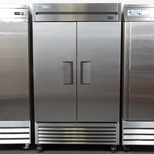 "True TS-43F 47"" Stainless Steel Two Section Solid Door Reach in Freezer"