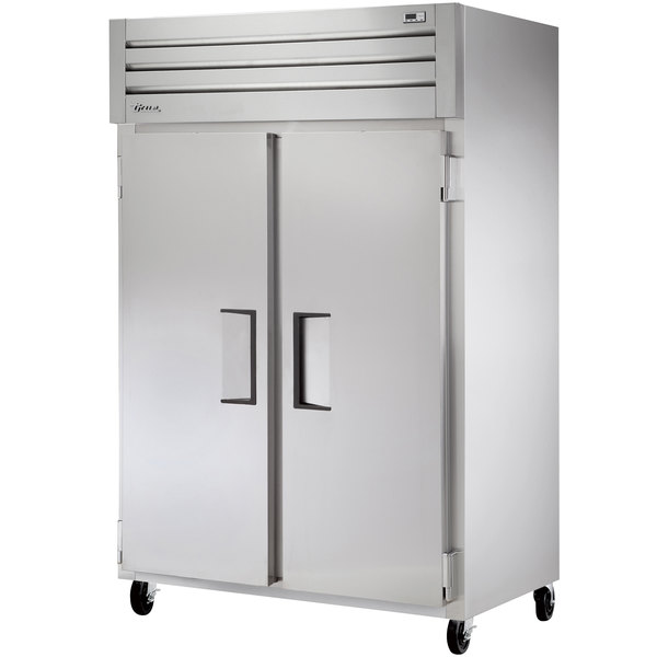 "True STM2F-2S 52"" Two Section Solid Door Reach in Freezer"