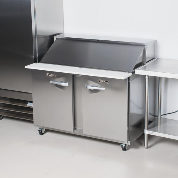 "Traulsen UPT488-LR-SB 48"" 1 Left Hinged 1 Right Hinged Door Stainless Steel Back Refrigerated Sandwich Prep Table"