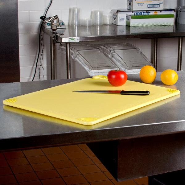 "San Jamar CBG182412YL 18"" x 24"" x 1/2"" Saf-T-Grip Yellow Cutting Board with Hook"