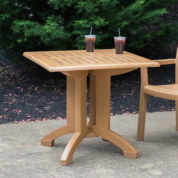 "Grosfillex US240208 Winston 32"" x 32"" Teak Decor Square Molded Melamine Pedestal Table with Umbrella Hole"