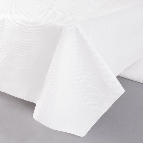 54 inch x 108 inch White Tissue / Poly Table Cover - 25/Case