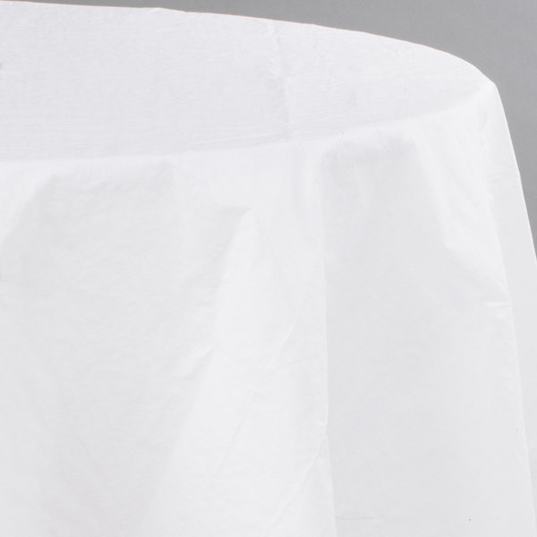 Creative Converting 923272 82 inch White OctyRound Tissue / Poly Table Cover - 12/Case