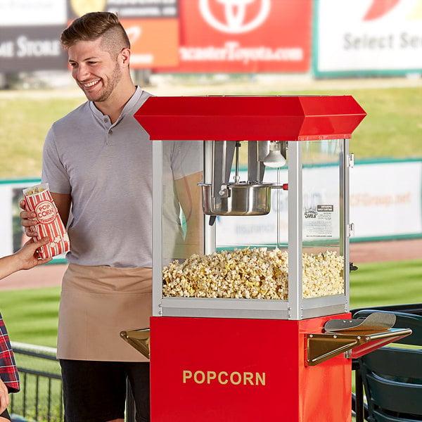 cashier handing customer popcorn