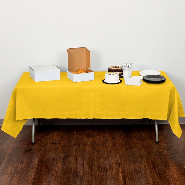 """Creative Converting 710234B 54"""" x 108"""" School Bus Yellow Tissue / Poly Table Cover - 24/Case"""