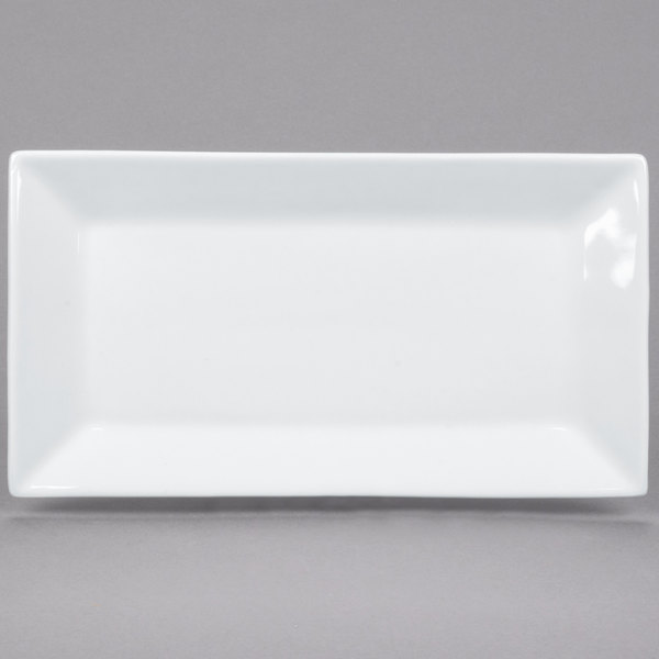 For a trendy departure from traditional dinnerware serve your menu items on this stunning Core 10\  x 5 1/2\  bright white rectangular platter. & Rectangular 10\