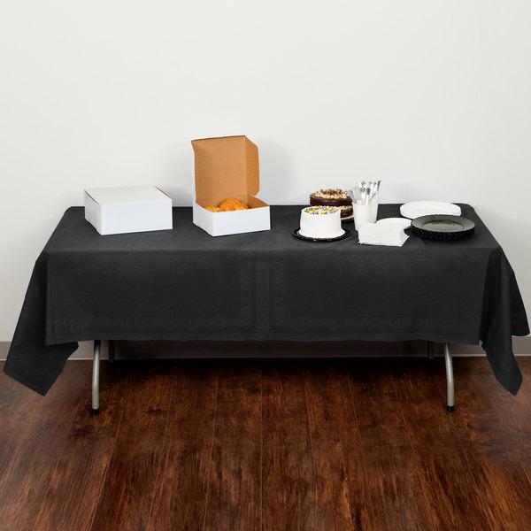 "Creative Converting 710126B 54"" x 108"" Black Velvet Tissue / Poly Table Cover"
