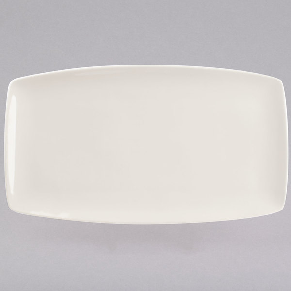 "Tuxton BEH-140Q DuraTux 14"" x 8"" Ivory (American White) Tapered Rectangular China Plate - 12/Case"