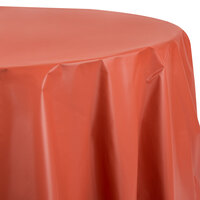 Creative Converting 703121 82 inch Brick Red OctyRound Plastic Table Cover - 12/Case