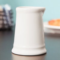 Tuxton BER-0351 DuraTux 3.5 oz. Ivory (American White) Creamer - 12/Case