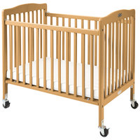 L.A. Baby CW-883A The Little Wood Crib 24 inch x 38 inch Natural Mini / Portable Folding Wood Crib with 3 inch Vinyl Covered Mattress