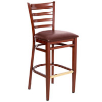 Lancaster Table &amp&#x3b; Seating Spartan Series Bar Height Metal Ladder Back Chair with Mahogany Wood Grain Finish and Burgundy Vinyl Seat