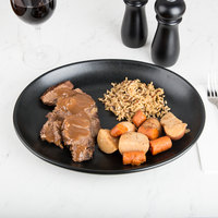 Hall China 303150AFCA Foundry 13 1/8 inch x 10 1/2 inch Black China Oval Platter - 6/Case