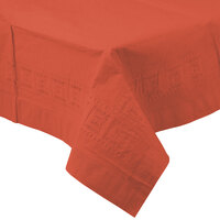 Creative Converting 713121 54 inch x 108 inch Brick Red Tissue / Poly Table Cover