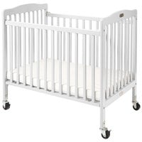 L.A. Baby CW-883A The Little Wood Crib 24 inch x 38 inch White Mini / Portable Folding Wood Crib with 3 inch Vinyl Covered Mattress