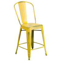 Distressed Yellow Metal Counter Height Stool with Vertical Slat Back and Drain Hole Seat