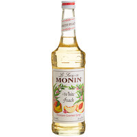 Monin 750 mL Premium White Peach Flavoring / Fruit Syrup