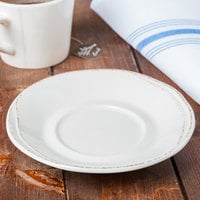 World Tableware FH-519 Farmhouse 6 1/4 inch Round Ivory (American White) Porcelain Saucer - 36/Case