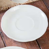 Tuxton TSC-002 Shell 5 1/2 inch Ivory (American White) Scalloped Edge Coupe Saucer   - 36/Case