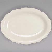 Homer Laughlin 52300 Carolyn 7 3/4 inch x 5 3/4 inch Ivory (American White) Scalloped Edge Oval Platter - 36/Case