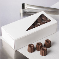 7 1/8 inch x 3 3/8 inch x 1 7/8 inch White 1 lb. 1-Piece Candy Box with Triangular Window   - 25/Pack