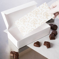 7 inch x 3 1/4 inch 3-Ply Glassine 1 lb. White Candy Box Pad with Gold Floral Pattern - 25/Pack