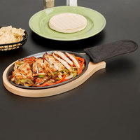 Choice 9 1/4 inch x 7 inch Oval Cast Iron Fajita Pan Set with Wood Serving Underliner and Black Cotton Handle Cover
