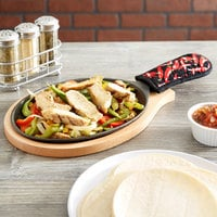 Choice 9 1/4 inch x 7 inch Oval Cast Iron Fajita Pan Set with Wood Serving Underliner and Chili Pepper Cotton Handle Cover
