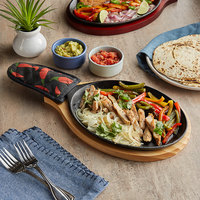 Choice 9 1/4 inch x 7 inch Oval Pre-Seasoned Cast Iron Fajita Skillet with Natural Finish Wood Underliner and Chili Pepper Cotton Handle Cover