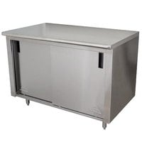 Advance Tabco CB-SS-304M 30 inch x 48 inch 14 Gauge Work Table with Cabinet Base and Mid Shelf