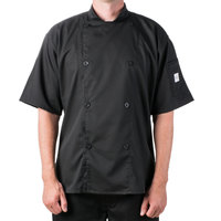 Mercer Culinary M61012BKXS Genesis Unisex 32 inch XS Customizable Black Double Breasted Traditional Neck Short Sleeve Chef Jacket with Traditional Buttons