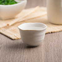 World Tableware RS-2 Hakone 2 oz. Miyagi White Stoneware Sake Cup - 36/Case