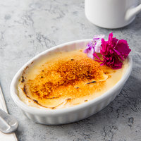 Core by Acopa 6 oz. Oval Bright White Fluted Porcelain Souffle / Creme Brulee Dish - 12/Pack