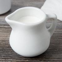 Tuxton BPR-035 DuraTux 3.5 oz. Porcelain White China Creamer - 12/Case